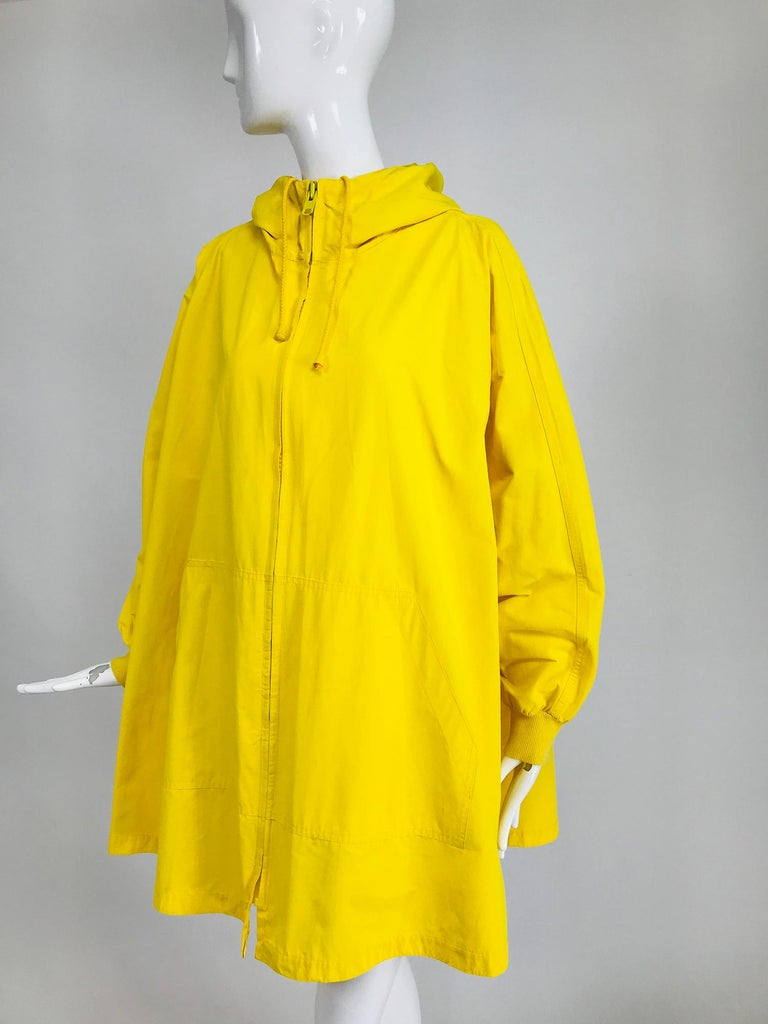 Vintage A Line Anne Klein bright yellow A line zip front jacket with hood. Statement making full A line cut jacket/coat with raglan sleeves, the jacket closes with a big chunky yellow zipper, all the way up to the chin of the attached hood, there is
