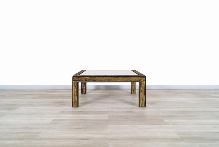 Wonderful vintage acid etched brass coffee table designed by Bernhard Rohne for Mastercraft in United States, circa 1970s. This coffee table presents a unique aesthetic throughout its structure. Features acid etched brass strips that show detailed