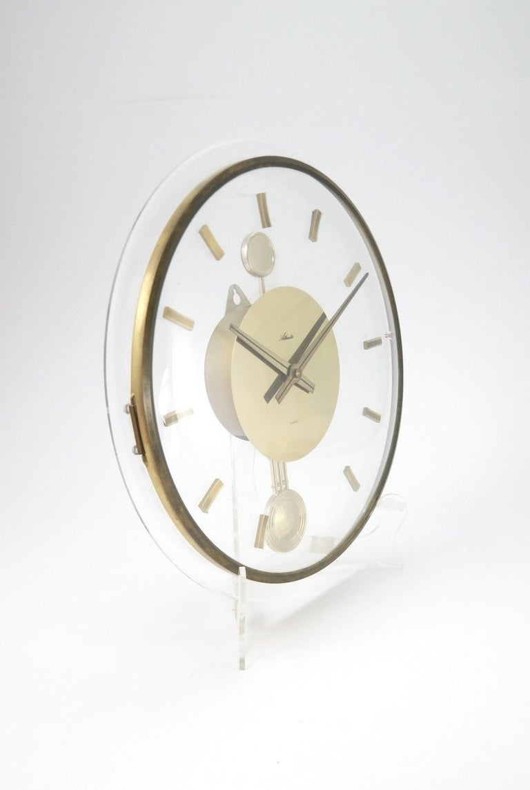 Vintage acrylic and brass wall clock, 1960s.