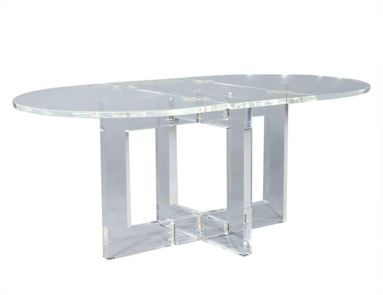 """Vintage acrylic modern drop-leaf dining table. This modern drop-leaf table is very rare and completely original. Composed of 100% acrylic, it has been re-polished like new and is the perfect fit for a bold home.  Measures: W 73"""", H 29.75"""", D 42"""","""