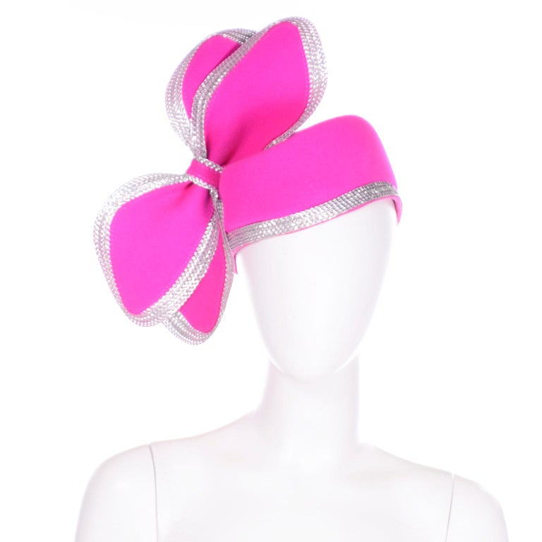 This outstanding vintage Adolfo II hot pink structured hat is a show stopper! We love the pretty structured bows and the way the hot pink wool is trimmed with woven metallic silver. The inside has a