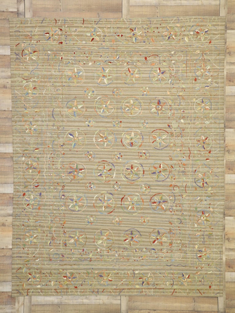 80111, vintage Afghan Uzbek Suzani embroidered Kilim rug with Bohemian style. This handwoven wool vintage Afghani Uzbek Suzani kilim rug features an embroidered bohemian style. The Suzani style kilim rug displays an array of large and small circles