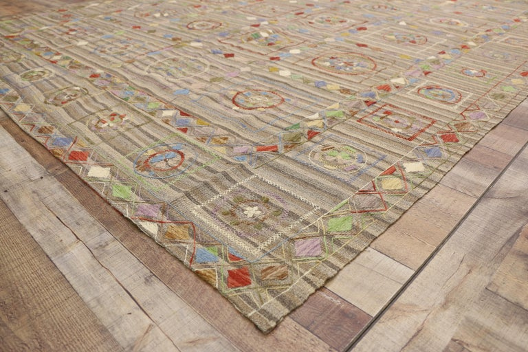 80114, vintage Afghan Uzbek Suzani Embroidered Kilim rug with Bohemian style 07'10 x 09'07. This handwoven wool vintage Afghani Uzbek Suzani Kilim rug features an embroidered Bohemian style. The Suzani style Kilim rug displays a compartmental field,