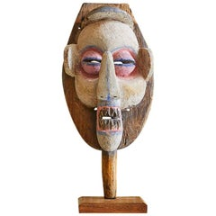Vintage African 1950s Wooden Mask on Stand and Painted in Pink and Blue