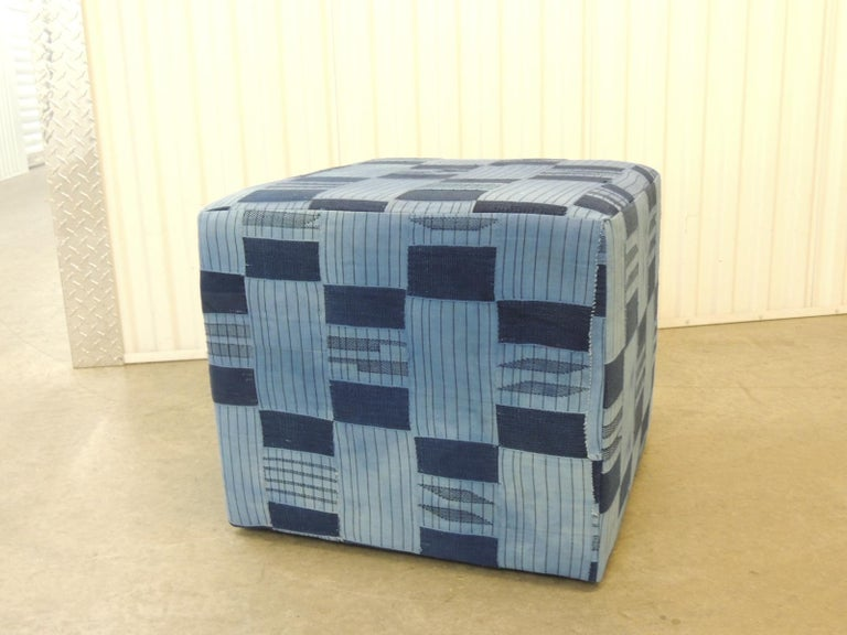 Vintage African blue and indigo woven textile custom square ottoman. Wood frame with padded construction all around and small tack feet.