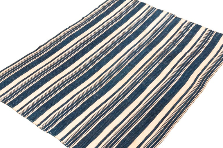 There is nothing like real indigo derived naturally from the Indigo fera species of plant. The color is mesmerizing because of its richness. Hand dyed on hand-spun cotton this blue and white stripe wrap is a great example of these tribal weavings.