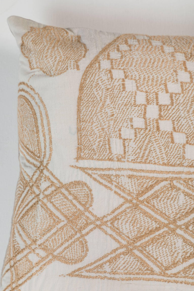 Pat McGann Workshop Made from a Hausa Chief's Robe, known as a Boubou.  Hausa is the largest tribal group in Nigeria.  Embroidery over hand woven fabric made in narrow panels sewn together. Natural linen back.  Invisible zipper closure, feather and