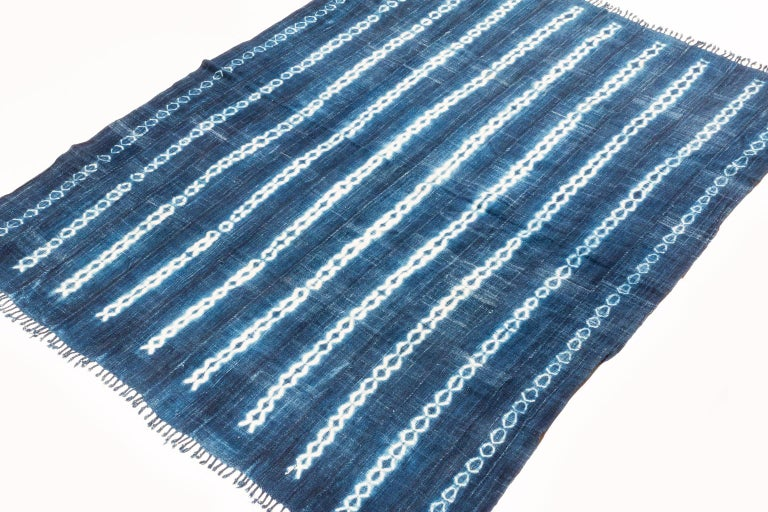 Very soft hand spun cotton, luminous indigo blue color with white design motfs. The ends are finished with nice braid-work. A great vintage tribal piece. Measures: 3'7