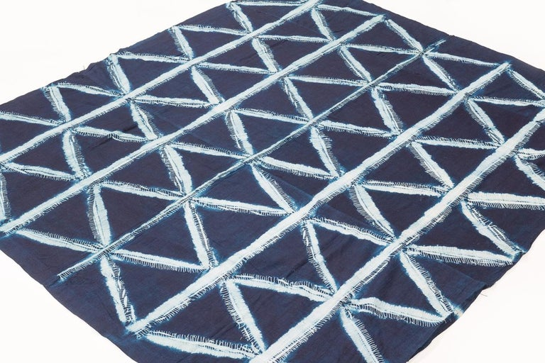 Just a stunning piece. This is a rare textile of exceptional artistic merit. The repetitive geometric motif is produced by a 'wax' resistance technique, similar to hollandaise wax techniques, create clean and graphic shapes. This would make a