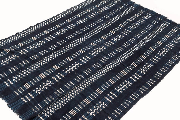 Natural Indigo on hand-spun cotton. We believe this piece was woven in Burkina Faso, possibly Lobi tribe. Measures: 3'6'' x 5'3''.