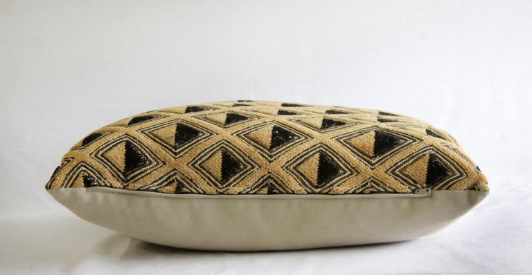 Vintage African Kuba Cloth pillow black and tan pattern, back side is natural cotton.  Measures: 17