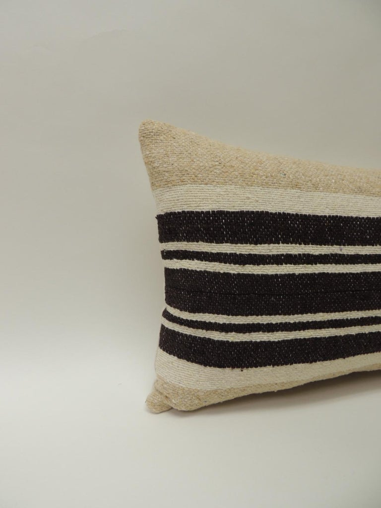Vintage African woven tribal artisanal textile decorative pillow Tunisian vintage artisanal tribal textile decorative pillows handcrafted from the vintage wool and hemp hand-loomed by the Berber tribes from the Atlas Mountains of Morocco. Natural