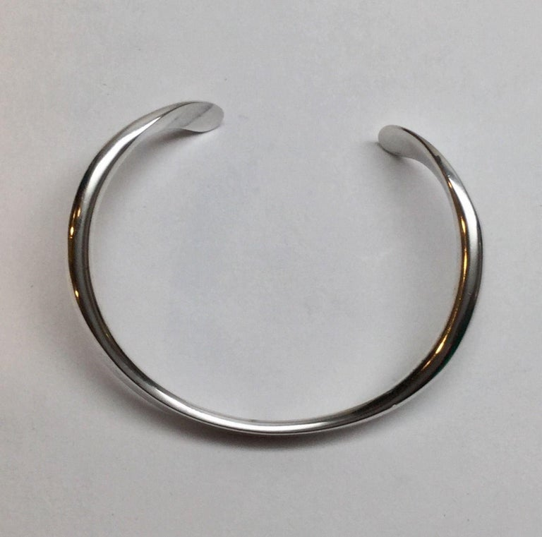 Vintage Age Fausing Denmark sterling silver modernist curved cuff bracelet.   Marked A with circle on top with two lines under in circle of STERLING DENMARK FAUSING.   Measures 6 1/4