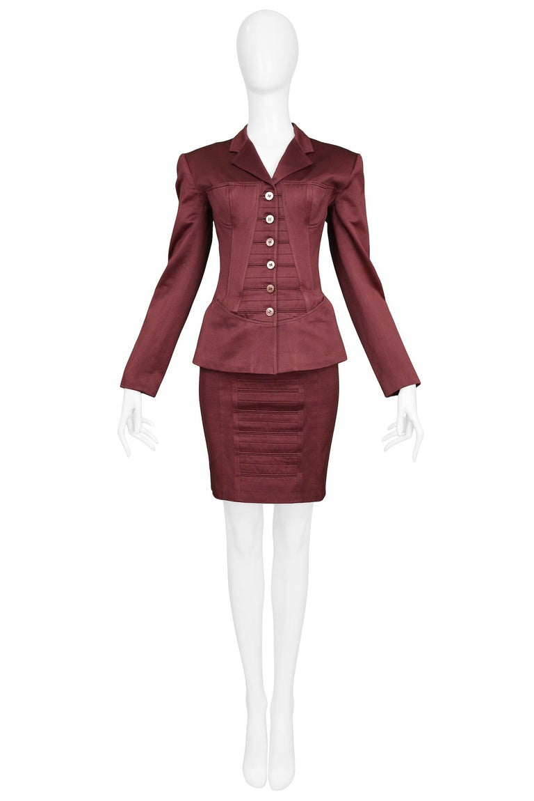 Vintage Azzedine Alaia burgundy corset skirt suit with bra detail and tonal buttons. From the Spring / Summer 1992 Collection.   Excellent Condition.  Size 38 Jacket Measurements: Shoulder 16.75