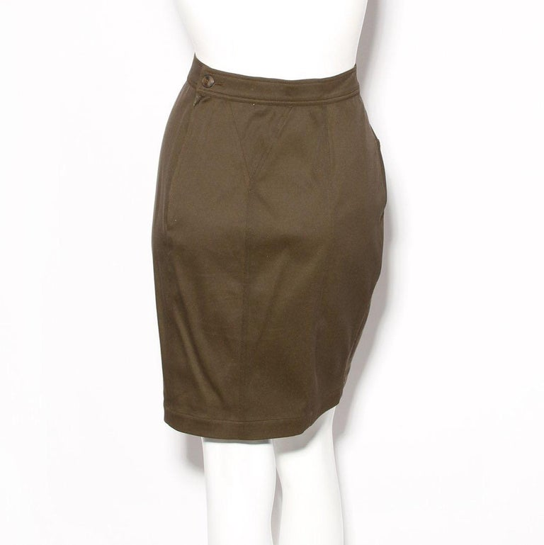 Product Details: Vintage skirt by Azzedine Alaia Olive green Decorative seams  High waisted skirt Zip back and button closure  Made in France Condition: Excellent vintage condition, little to no visible wear. Sold as-is (see