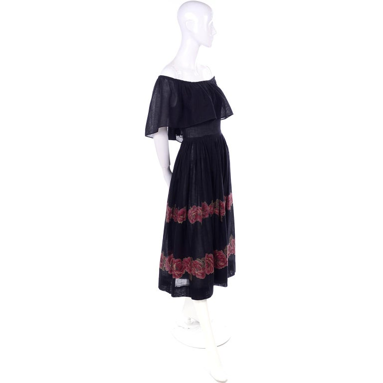 This is a fun Albert Nipon vintage semi Sheer black cotton voile dress with two rows of rose floral print around the bottom of the skirt. The dress can be worn as shown or on the shoulders. We love Albert Nipon and really think he had a knack for