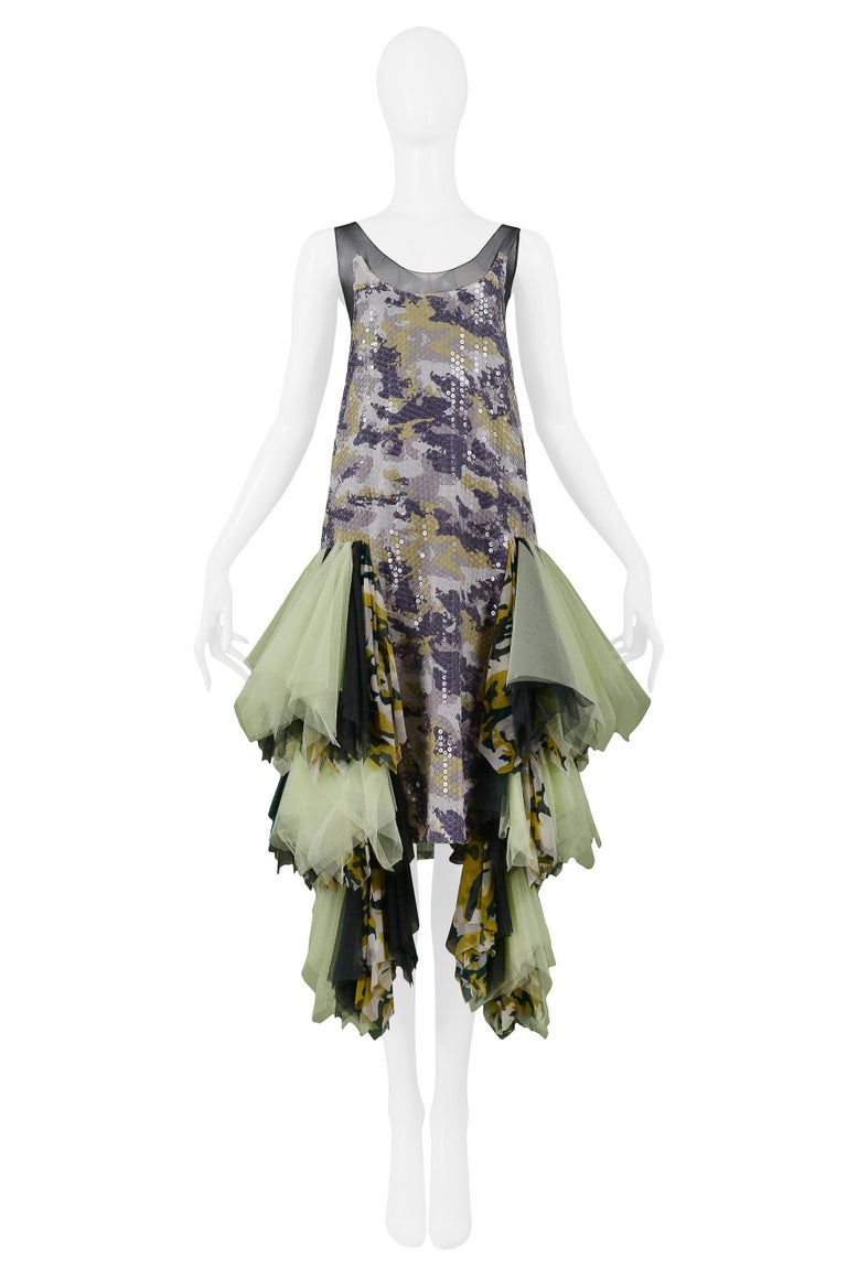 We are excited to offer an important vintage Alexander McQueen green, purple, and grey camo robe-de-style slip dress featuring sheer mesh straps, clear sequins, and multicolor green & camo chiffon ruffled tiers at hips. The dress fits like a vintage