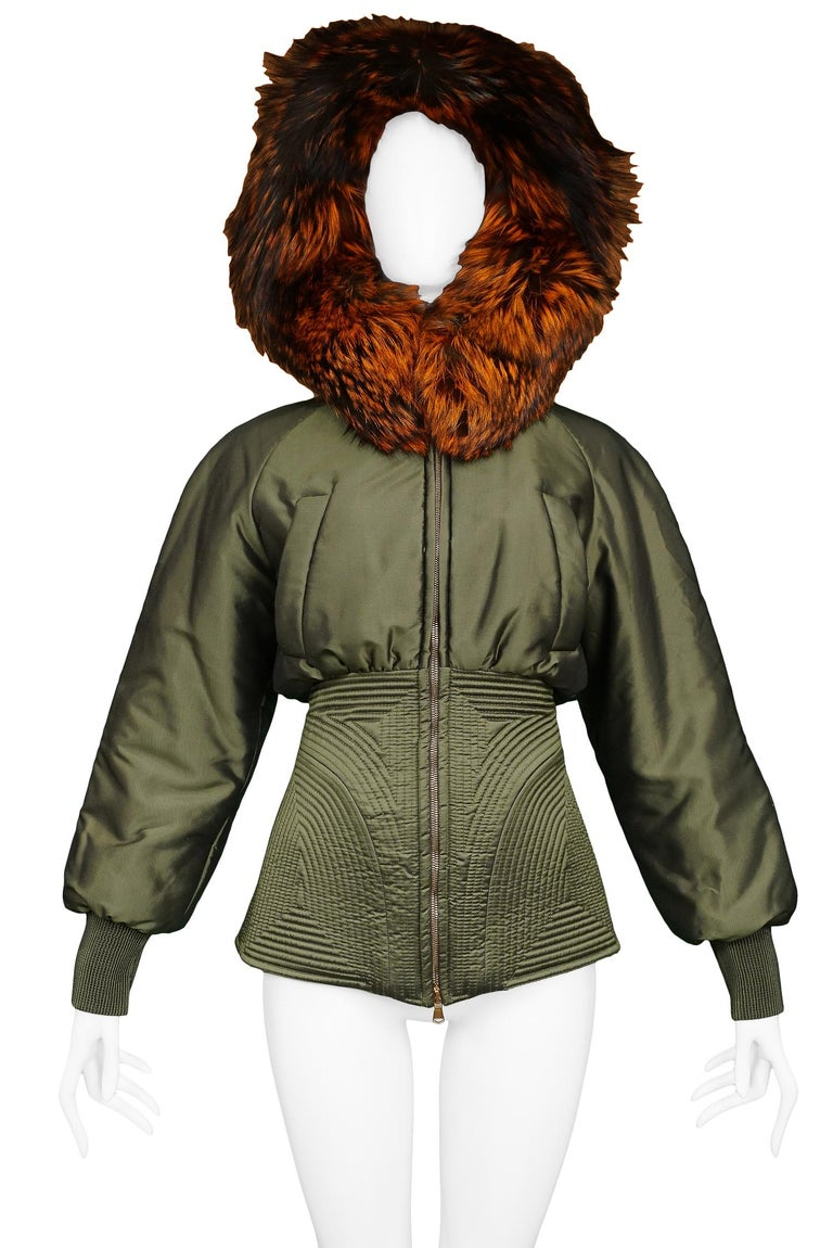Vintage Alexander McQueen metallic military green corseted parka with auburn fox fur trim. Runway piece from the Autumn/Winter 2007 Collection.   Excellent Vintage Condition.  Size 38  Measurements: Bust 38