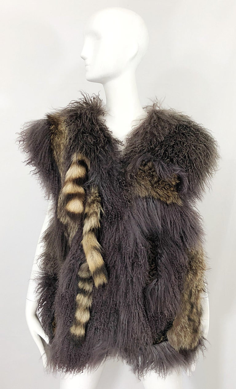 Avant Garde AMEN WARDY 1970s mixed fur and leather grey and brown sleeveless vest! Features luxurious Mongolian fur, Raccoon fur tails, Fox fur, and brown leather throughout. Two strong fabric covered hook-and-eye fur closures up the front. Pockets