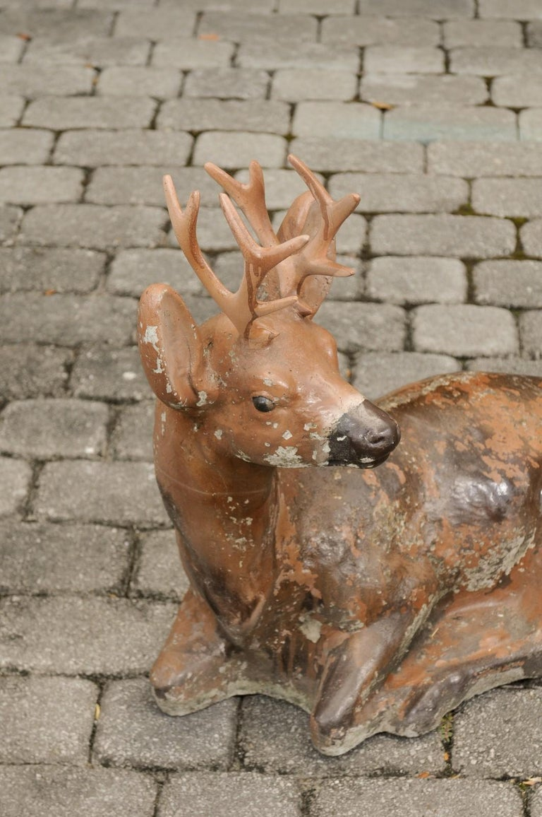 Vintage American Concrete Reclining Deer Sculpture with Iron Antlers and Patina In Good Condition For Sale In Atlanta, GA