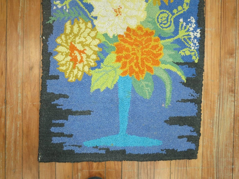 An American Hooked rug from the middle of the 20th century with a flower vase design.
