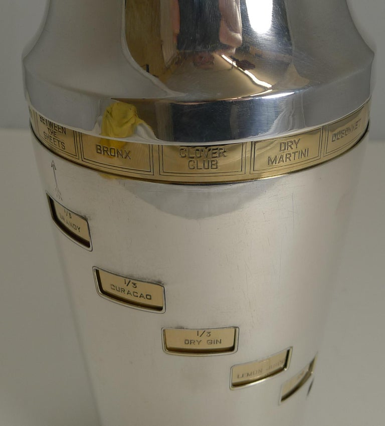 A magnificent original vintage 1930s recipe cocktail shaker just back from our silversmith having had all the gold and silver plating professionally restored and polished to create an outstanding example.