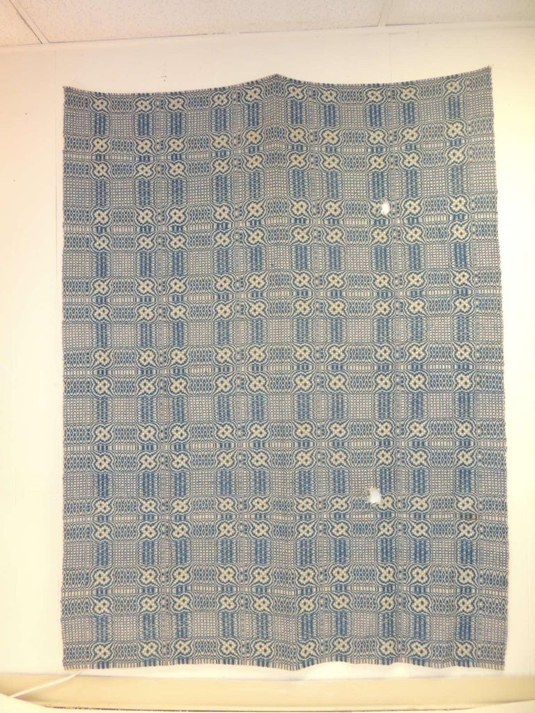 Vintage Americana style blue and white woven coverlet. Reversible square and circle pattern, rustic style. Sold as is (two holes from wear) Size: 61