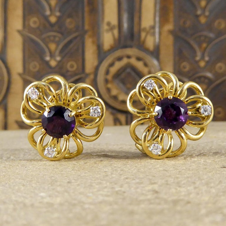 These cute little omega clip vintage earrings host one Amethyst stone in the centre of each earring weighing a total of 2.50ct. These unique earrings are formed in the shape of a flower from 18ct Yellow Gold with three Diamond set in each of