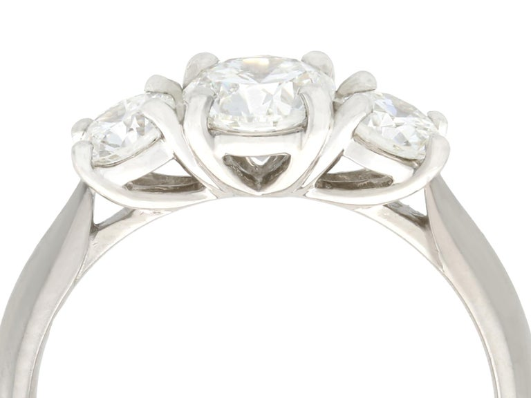 A fine and impressive 1.24 carat diamond and platinum three stone dress ring; part of our diverse vintage diamond engagement ring collections.  This stunning vintage and contemporary diamond trilogy ring has been crafted in platinum.  The plain