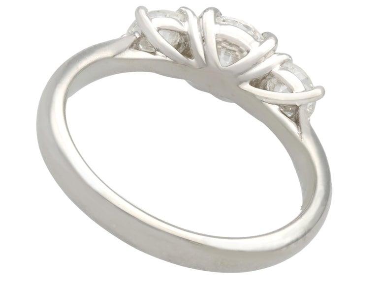 Round Cut 1.24 Carat Diamond and Platinum Three-Stone Ring For Sale