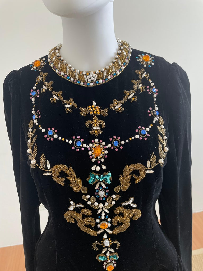 Vintage and Rare Oscar de la Renta Gown with Jeweled Neckline featuring crystals and pearls. This romantic velvet gown has gold embroidered along the neckline that will make you feel regal. Size US 10.