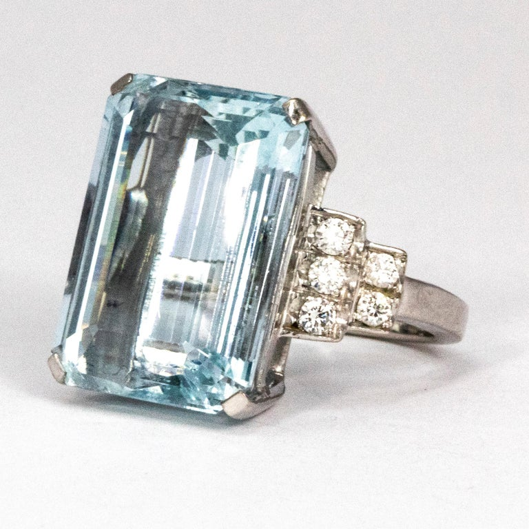 The gorgeous pale blue emerald cut aqua in this cocktail ring is stunning. Either side of the giant stone are diamond encrusted shoulders holding five diamonds measuring 4pts each.   Ring Size: I or 4 1/4  Stone Dimensions: 17.5mm x 12.5mm