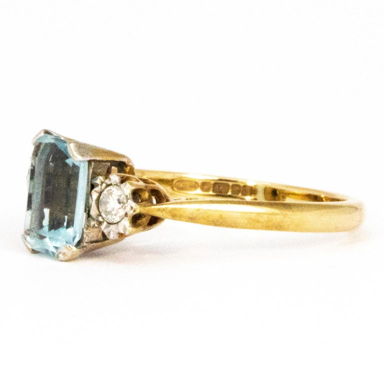 The centre stone on this gorgeous ring is an emerald cut aqua stone measuring 1carat. Either side of this pale blue stone are two round cut diamonds measuring 10pts each. The contrasting shapes of the stones make this ring very stylish. Modelled in