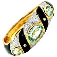 Vintage Aquamarine Diamonds Onyx 18 Karat Gold Bangle Bracelet, circa 1970-1980