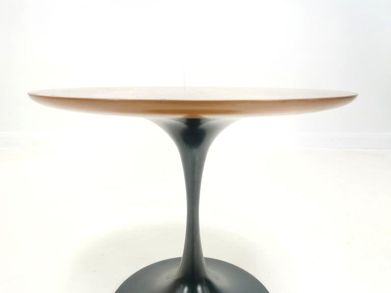 Arkana teak occasional table  Occasional table by Maurice Burke for Arkana.  Circular shaped teak top which sits on a heavy steel tulip base,  circa 1960s. Made in the UK. Stamped by the maker.  Dimensions:   45 W x 45 D x 38