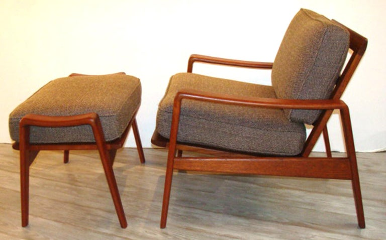 Rarely available. Two matching Arne Wahl Iversen chair/ottoman sets (priced individually for each two-piece set as shown in primary photo). Solid teak frames with restored finish and newly upholstered cushions. Ottomans retain original Fagas straps.