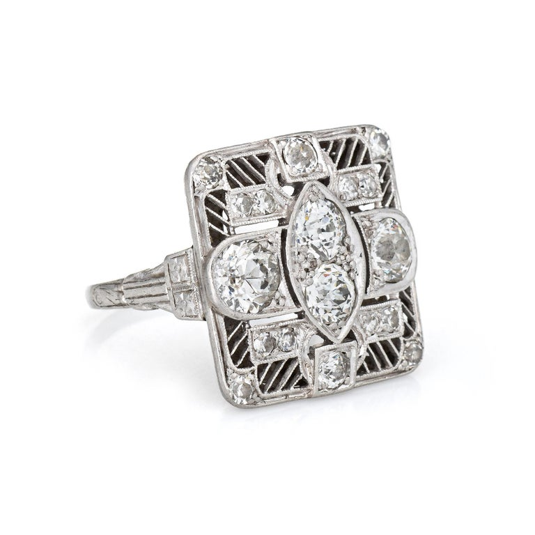 Finely detailed vintage Art Deco era diamond ring (circa 1920s to 1930s) crafted in 900 platinum.   Old European and single cut diamonds total an estimated 1.50 carats (estimated at I-J color and VS2-SI2 clarity). The four larger old European cut