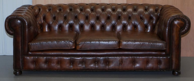 We are delighted to offer for sale this lovely vintage Art Deco circa 1920s aged hand dyed brown leather sofa with coil sprung base  I have the matching armchair listed under my other items  This is a very good looking well made and comfortable