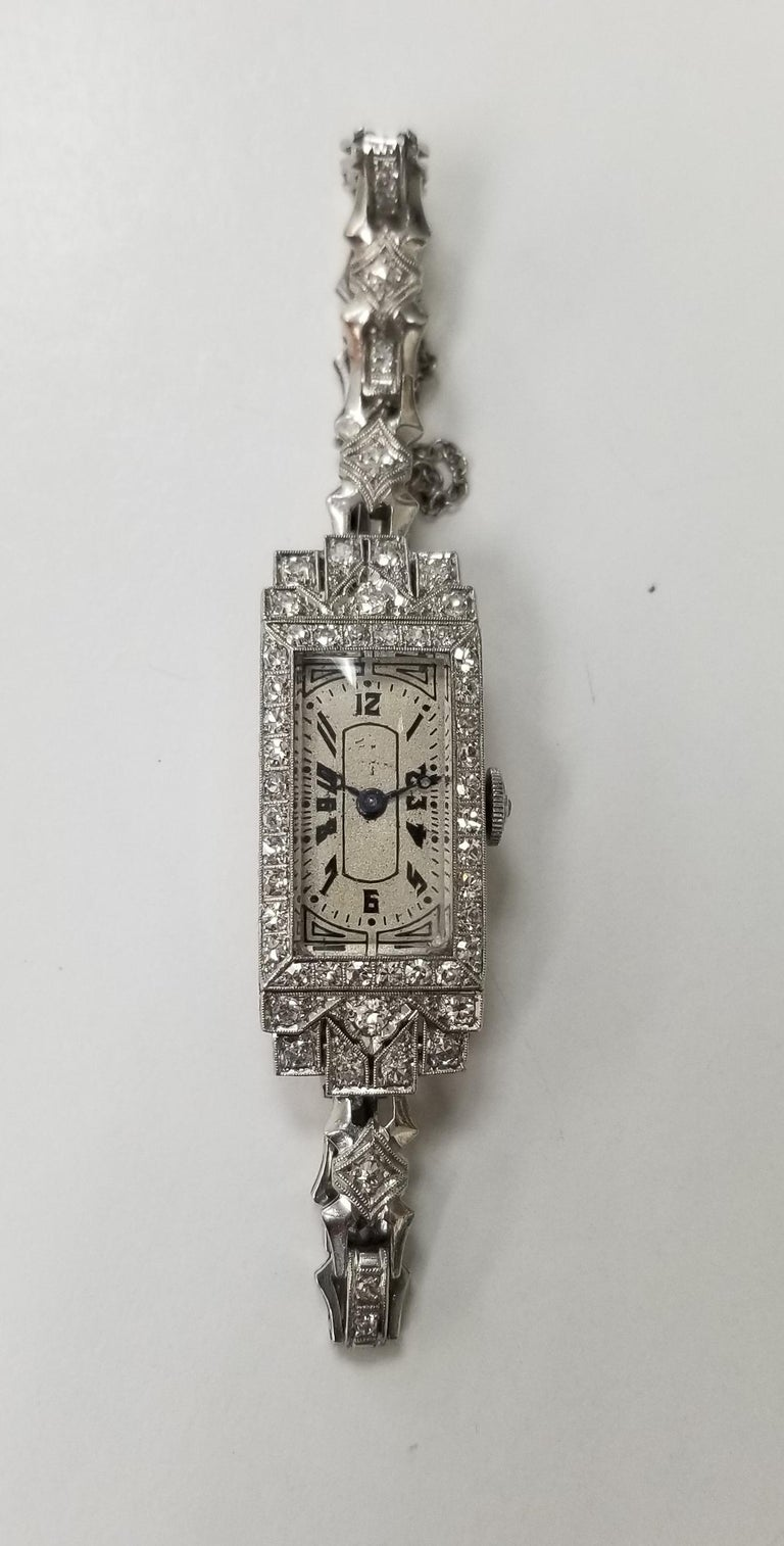 Vintage Art Deco Palladium diamond watch, containing 65 round single cut diamonds of very fine quality weighing approximately 1.50cts.  The watch is engraved from 1919. Length is 6 1/4 inches with a safety chain