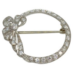Vintage Art Deco Platinum Filigree Brooch Circle with Ribbon 1.45 Carat