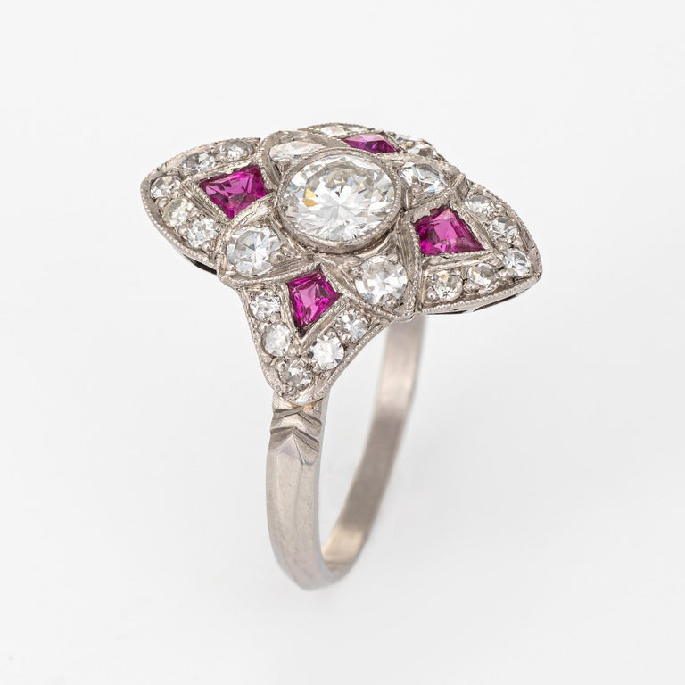 Elegant & finely detailed Art Deco era ring (circa 1920s to 1930s) crafted in 900 platinum.   Centrally mounted estimated 0.50 carat transitional cut diamond is accented with a further 0.40 carats of diamonds (estimated at H-I color and VS2-SI1