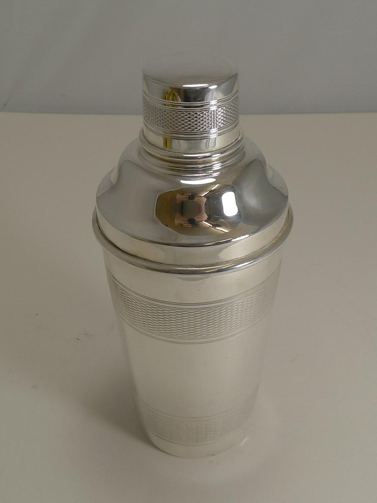 A handsome vintage silver plated cocktail shaker with engine-turned decoration.