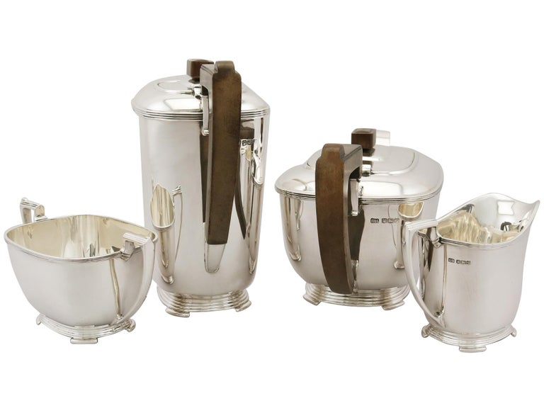A fine vintage George VI English sterling silver four-piece tea and coffee service in the Art Deco style; an addition to our silver teaware collection.  This exceptional vintage sterling silver tea set consists of a coffee jug, teapot, cream jug
