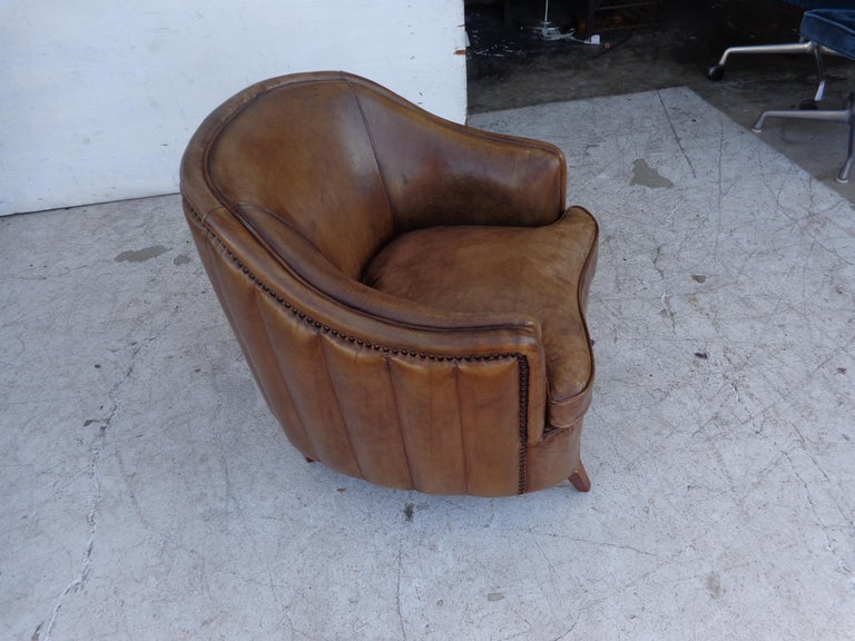 Vintage Art Deco style barrel club chair  Petite aged leather club chair. Channel back with studs.  Measures: 24? Width x 29? depth x 27? height Seat Height 17? Arm Height 20.5?.