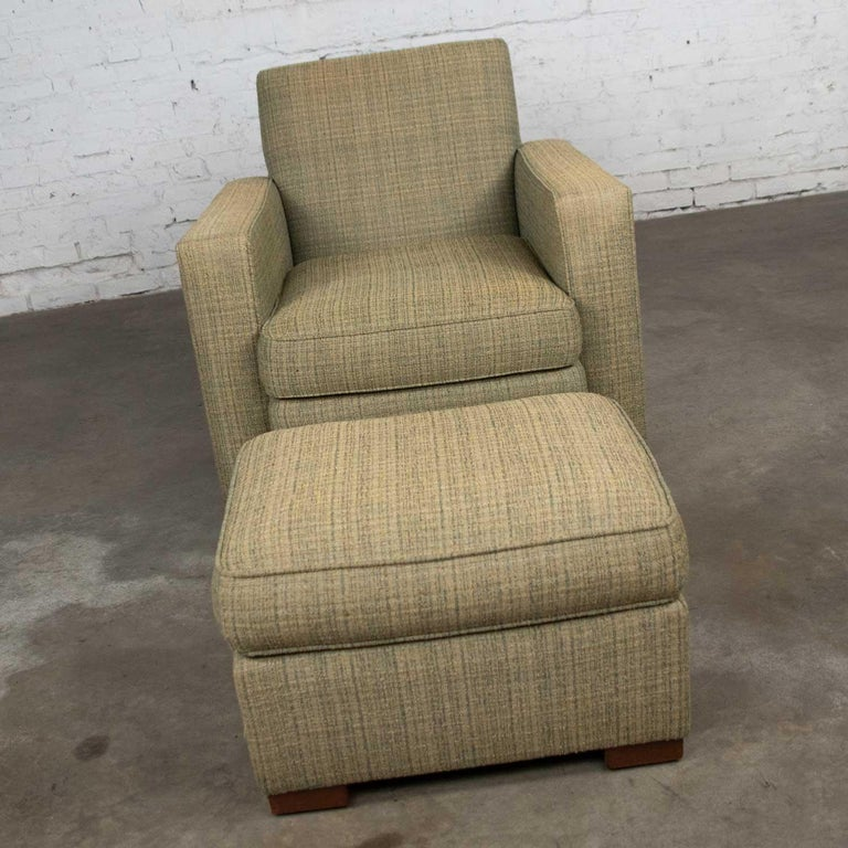 Handsome Art Deco style club chair and ottoman by Hickory Chair in a green tweed like fabric. They are in fabulous vintage condition. They have been professionally cleaned and are ready to use. There is a bit of discoloration on the very top edges
