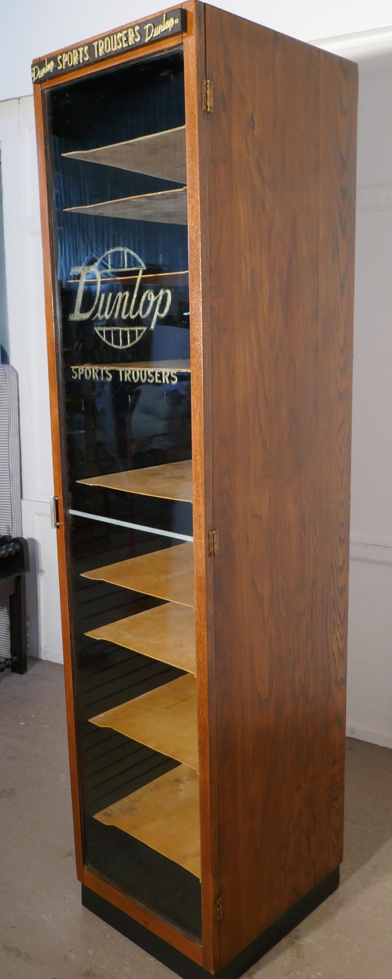Early 20th Century Vintage Art Deco Tall Haberdashery Dunlop Sports Cabinet For Sale