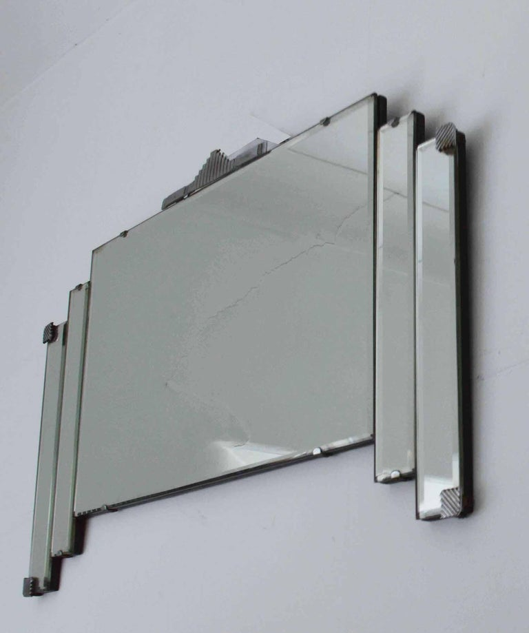 Very smart Art Deco or modernist wall mirror.  English, 1930s  Great shape and condition.  I particularly like the chrome hardware to the corners and top.