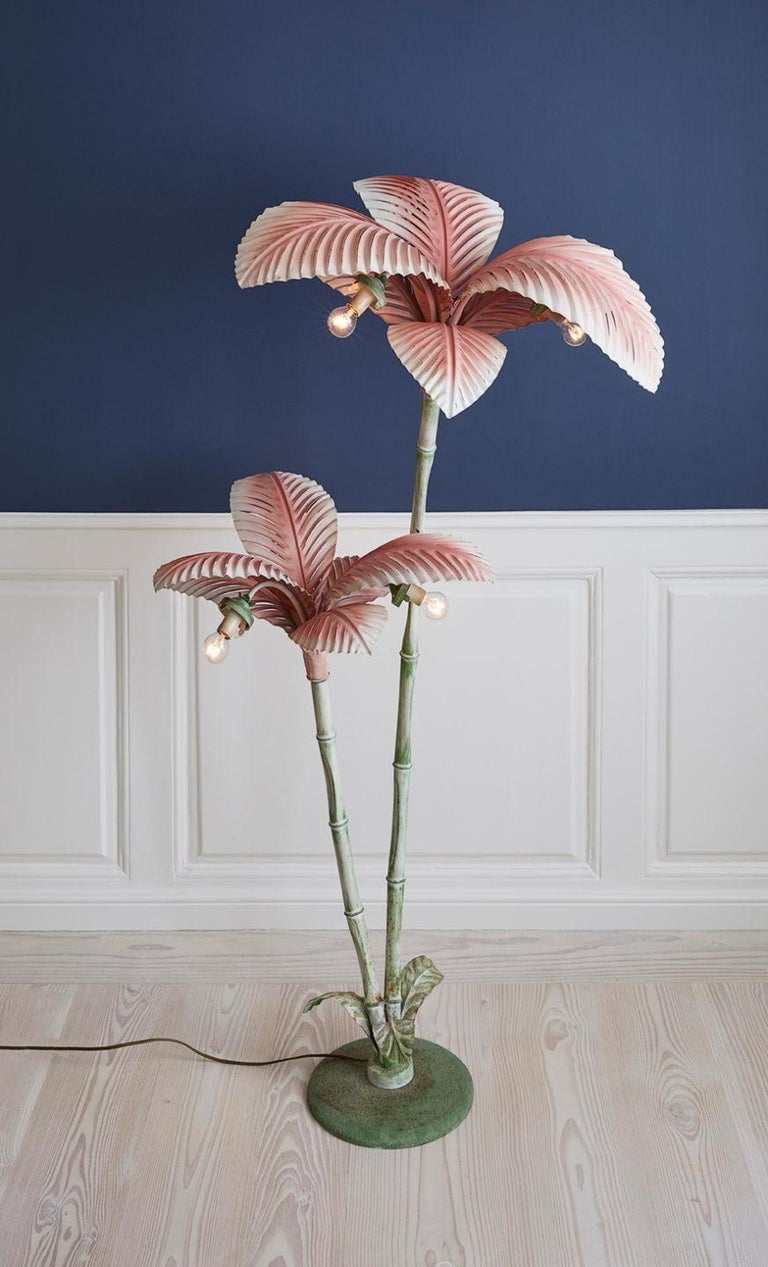 Eccentric vintage floor lamp in the shape of a palm tree with soft green and pink tones. The floor lamp is of painted metal, produced in Italy during the 1940s in the style of Art Nouveau.