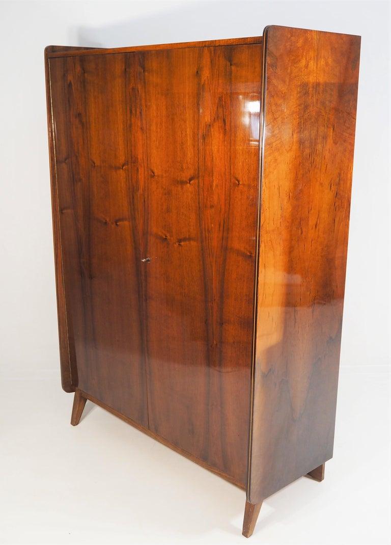 Czech wardrobe for Tatra, 1970s. Original condition. Walnut wardrobe dimensions: Height 172 cm, width 118 cm, depth 52 cm.