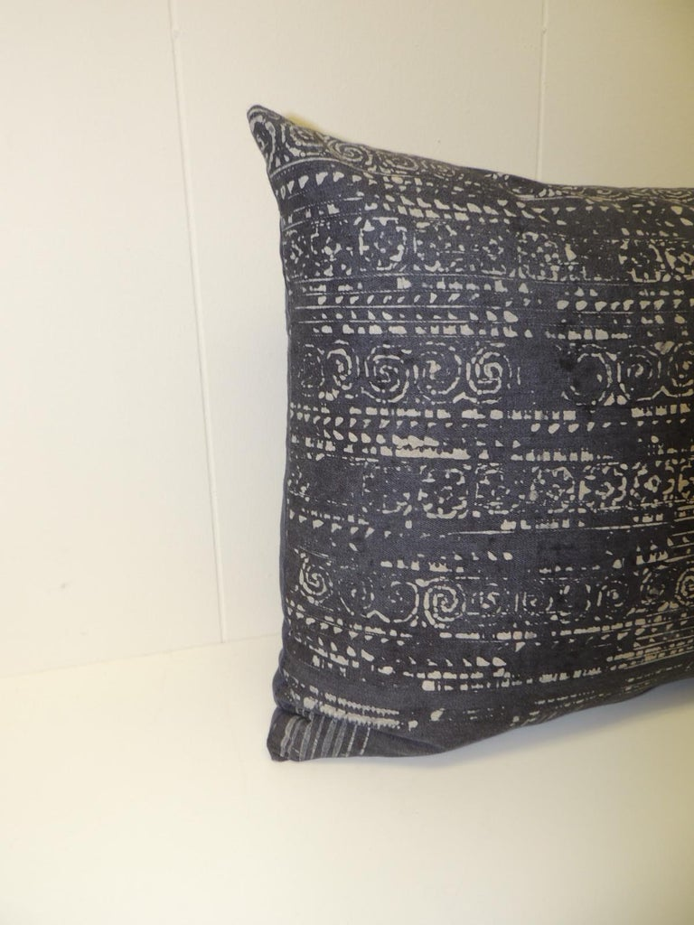 Vintage hand blocked batik decorative bolster pillow. Decorative lumbar pillow handmade with a hand-blocked indigo and white tribal patterns on the vintage textile. Decorative cushions finished with deep blue linen backing. Throw vintage pillow